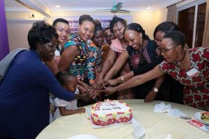 A section of the Association Officials Join in the Cake Cutting